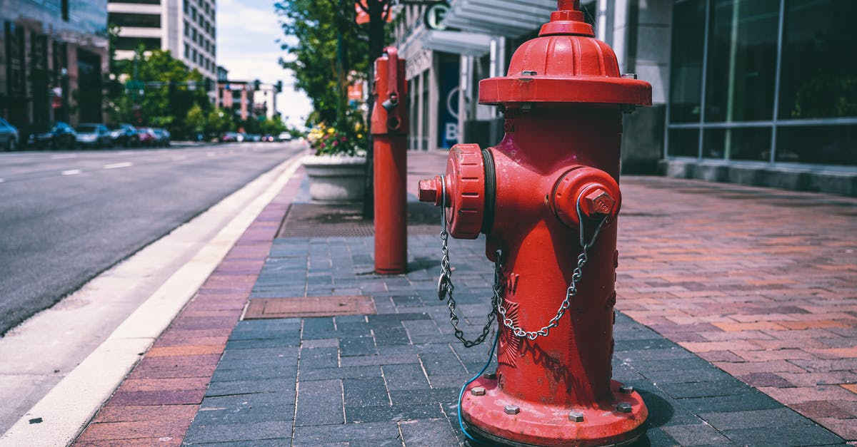 A fire hydrant sitting on the side of the street